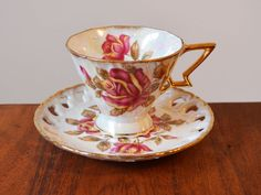 Royal Sealy Art Deco Iridescent Teacup and Saucer, with massive magenta roses - angular gold handle and reticulated saucer edge, Japanese by Trashtiques on Etsy https://www.etsy.com/ca/listing/517017535/royal-sealy-art-deco-iridescent-teacup