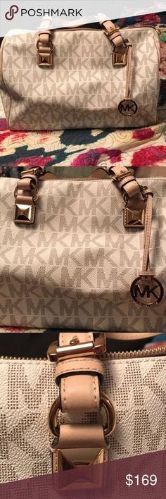 NWOT Michael Kors Bag Jet Set logo. NWOT. This bag is stunning. It has been in my closet and deserves to be carried. Dress it up or dress it down. Endless options! Michael Kors Bags Satchels
