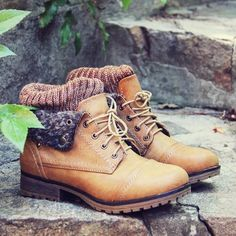 """Chilly nor'wester winds won'tbother you this fall in these darling cozy boots. A soft tan base pairs with a flap-over top design and sweetboot sock detail. Lace-up front with a rugged treaded sole.A soft plaidinner lining and padded foot bed make for the perfect fall and winter boots.  Color: Tan Heel Height: 1"""" Boot Height: 6"""""""