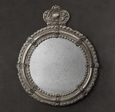 Restoration Hardware  ARGENTINIAN CROWN MIRROR  Re-creating a historic silver antique from Buenos Aires, our mirror captures the ornate décor brought from Spain to the New World centuries ago. With its beaded double borders and a crowning emblem, the mirror is grand in style and scale.