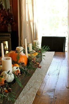 Great inspiration for a table. ~ DIY:: Stunning planter box filled with the perfect combination of greenery, pumpkins, gourds and candles! Truly a breathtaking centerpiece for Thanksgiving Diy Thanksgiving Centerpieces, Thanksgiving Tablescapes, Holiday Tables, Autumn Centerpieces, Rustic Thanksgiving, Christmas Tables, Happy Thanksgiving, Christmas Decorations, Diy Deco Halloween