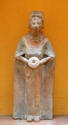 Maya Woman Figurine by Teyacapan, via Flickr.     This modern reproduction of an ancient Maya figurine occupies a nicho in a colonial home in San Cristobal de las Casas Chiapas Mexico.  Good to see the ancient skills are still there.