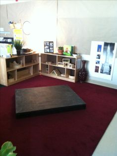 Block center for preschool, black platform with chalk board paint for kids to create roads, towns, etc. - love it