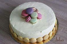 Fresh raspberry mascarpone cake with colorful macarons
