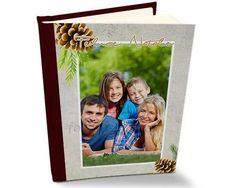 Album con pigne e ramoscelli natalizi