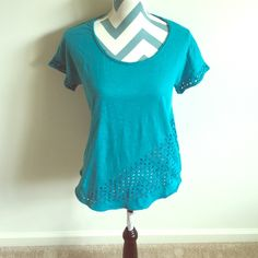 Lucky Brand Top Beautiful short sleeve top with eyelet design on front, back, and around sleeves. In like new condition with no flaws. It is a size XS but runs oversized and fits like a small. A beautiful turquoise blue. Lucky Brand Tops