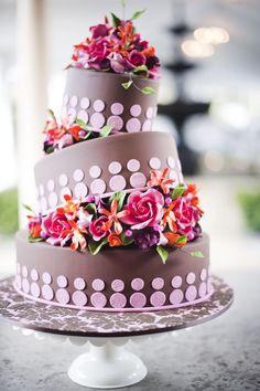 Really lovely, though I can't help but laugh imagining little funny monsters breaking out of the cake instead of flowers.