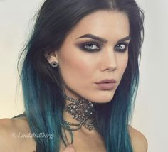 Dark brown and turquoise hair.