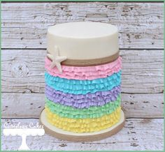 Pastel beach cake by Cuteology Cakes.  The ruffles are piped buttercream - amazing work!