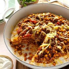 Chuck Wagon Tortilla Stack Recipe -Piling on loads of hearty flavor at mealtime is easy when I roll out this skillet specialty. I layer the meat mixture with tortillas in a deep skillet and let it simmer a little longer. It's easy to cut and spoon out of the pan. —Bernice Janowski, Stevens Point, Wisconsin