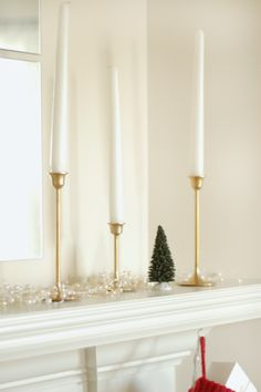 (mantle decorated with candlesticks & mini trees) A few small, random Christmas details that we're enjoying around the house lately. Simple Christmas, Mantle, Candlesticks, Elegant, My Style, Friday, Decor, Bronze, Classy
