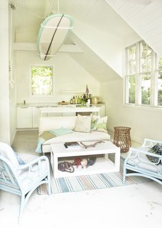 I love the clean, spa, and ocean style of this small space. The rope and buoys under the coffee table is so neat.