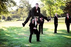 The Best Man plays leapfrog with the groom in this surprising and fun photograph from a wedding in Hopewell, PA at The Club at Shadow Lakes. The groomsmen's black ties feature the wedding's primary color, red, while the groom wears a subtle ivory white tie that blends with his crisp white shirt. The guys  showed their moves off again later that evening at the reception,  where the John Parker Band kept them dancing all night long with a variety of hits. http://www.jpband.com/weddings.html