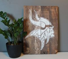 Minnesota Vikings Pallet Art 14x20 by SamBeeDesigns on Etsy.  Love it but we would have to get a packer one too to keep things even lol