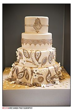 Beautiful white #Mendhi inspired Indian Wedding #Cake ~ follow us http://www.pinterest.com/proimagegroup ~ like us on https://www.facebook.com/Professionalimagephotography