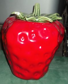 Strawberry Cookie Jar...like the jar & canisters & accessories mom had in her black & white kitchen.
