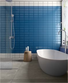 Our Bella Muro collection features over a dozen color ways; some are in an easy to design with matte finish and others are classically glossy. In addition, the rectangular shape opens lots of possibilities for creative flow. Glazed Ceramic Tile, Glazed Tiles, Minimalist Bathroom Design, Modern Minimalist, Black Interior Doors, Interior Minimalista, Blue Floor, Bathroom Tile Designs, Wall Tiles