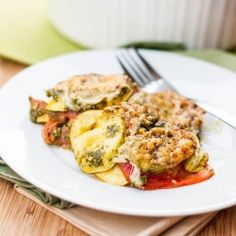 Full of summer flavors this Squash, Tomato and Pesto Gratin is a perfect vegetarian meal.