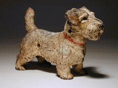 "3. Cast iron and painted two part Sealyham terrier form door stop. Length 13"". Gavel: $ 928.13"