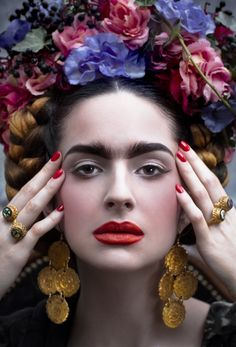 Frida Kahlo by CINQ Flowers and concept: Guy Debast Photographer: Isabella Abel  Model: Cornelia - Look Models Internnational Stylist: Judith Jules Beck  Hair and makeup: Roberto Caro  Fashion: Dress: Lena Hoschek, Cape: Love Irene, Shoes: Prada Jewelry: Earrings: Kenneth Jay Lane, Rings: Petra Hauser