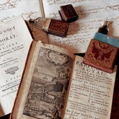 18th century French perfume bottles with stamps and a book on how perfume is made.... via fragonard.com