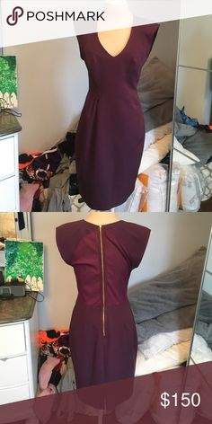 Black Halo royal purple dress perfect condition Only worn once Black Halo royal purple dress with shoulder pads and gold zipper with mesh accents Black Halo Dresses Midi