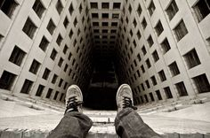 These vertigo-inducing images were taken by Daredevil Dennis Maitland, 24 who scales derelict buildings in Detroit to take astonishing birds-eye shots. He climbs into lift shafts, up former office blocks and over the edge of balconies to snap his incredible photos, looking directly down.