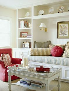 Decorating in small spaces can be a real challenge.  In this pic, the living room area can double as a guest room.  Pretty and practical bookshelves and hard-wired sconces save on space as well.  BHG