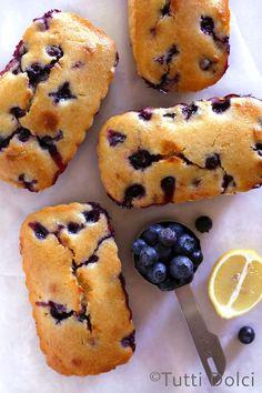 MIni blueberry lemon loaf cakes brushed with lemon syrup!
