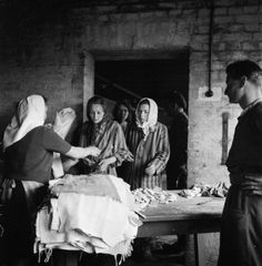 THE LIBERATION OF BERGEN-BELSEN CONCENTRATION CAMP,  MAY 1945. Women inmates receive clean towels and soap at the cleansing station.