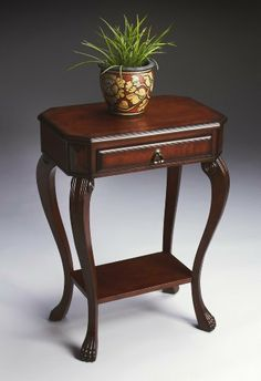 """Butler Specialty Console Table Plantation Cherry Finish by Butler. $199.00. Some assembly required. Plantation cherry finish. Weight: 32 lbs. Console table. Dimensions: 22""""W x 15""""D x 30½""""H. 5021024 Features: -Console table.-Cherry veneer top.-Olive ash burl veneer border.-Drawer with cherry veneer front. Construction: -Constructed of selected solid woods, wood products and choice veneers. Color/Finish: -Distressed finish.-Antique brass finished hardware. Assembly Instructions..."""