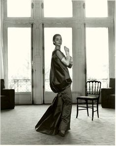 1955 French model Jackie is wearing Givenchy's red satin evening gown, photo by Walde Huth, Paris
