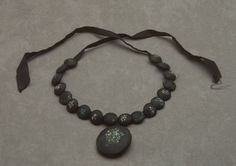 """Painted black silk-covered """"bead"""" mourning necklace with taffeta ribbon, American, mid-19th C."""