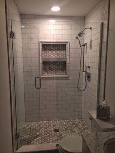 A classic look featuring ceramic subway tile and hex marble accents from our Brandon, FL showroom! We love it!