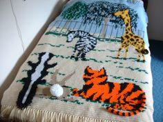 ZEBRA, GIRAFFE, TIGER, SKUNK, RABBIT Zoo Afghan with 3-D Tails. $300.00, via Etsy.