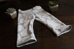 Giraffe Print Baby Leggings by monsterandthemoose on Etsy! Adorable little bottoms that make amazing baby shower gifts! Stylish and comfortable!