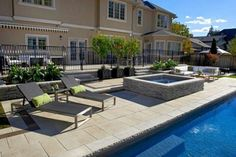 Umbriano paver pool deck with Rivercrest hot tub by Unilock