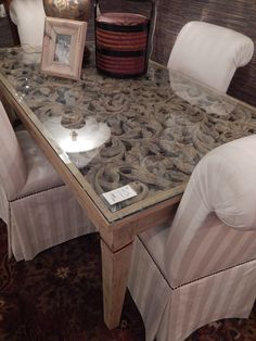 Stunningly unique carved dining table with 4 beautiful silk parsons chairs!