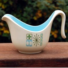 This creamer is an atomic mid-century modern design by Taylor, Smith & Taylor (which was founded in 1899 and closed in 1981). This is the Cathay pattern, which often has a mint green interior, but this is a beautiful robin's egg blue. This pattern was made from the late 1960s to early 1970s.  flickr.com/photos/calloohcallay