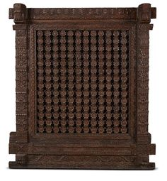 Such floral jaalis executed in wood fretwork are common features of havelis or manors constructed in the 18th – 19th century in Gujarat, especially in windows opening into the inner courtyard of the inner ground floor or on upper floors. The overall design and double frame of the windows give them the appearance of a small cantilivered balcony.#Gujarat, #18th19thCentury