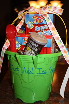 "Think we even have a bucket left from this years auction! - Get an inexpensive summer bucket & fill with ice cream cones, toppings, bowls, etc...tie on a cute ribbon and use a paint marker to write ""Just Add Ice Cream"".  Great teacher gift!"