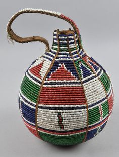 Africa | Vessel made from gourd, glass beads and leather (hide) | Kenya; possibly from the Kamba people | ca. 1914 or earlier
