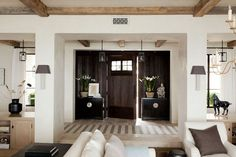 Portfolio m elle design - white oak or limed oak finish, dark chests, sconces, contrasts