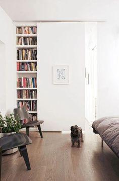 Bookshelves behind barn door~ john dwyer architect Sliding Door Design, Sliding Wall, Sliding Doors, Barn Doors, Wood Doors, Murs Mobiles, Garderobe Design, Door Storage, Storage Area