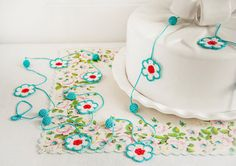 Aqua Red and White Crochet Flower Garland - Modern Kitchen Decor - Textile Arts    9 aqua, red, and white crochet flowers dangle from a 95 inch aqua