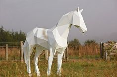 Stark White Animal Sculptures Contrast With Nature | Visual News