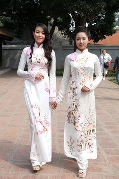 Cherry Blossom Ao Dai, traditional Vietnamese pre-wedding dress...I got one of these made in Vietnam..pure silk..pure elegance!