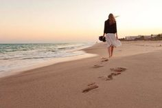 Photo about Woman walking away beach sand sunset sea ocean water summer vacation. Image of vacation, sunset, summer - 75900681
