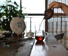 You need a yixing clay teapot if you like pu-erh or oolong tea.