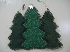This one taken with no flash. My first Holiday Door Hanger of the season.  I can't quite get a good picture of it to show off the metallic threads in the green burlap.